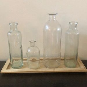 Decorative glass jars with wooden tray